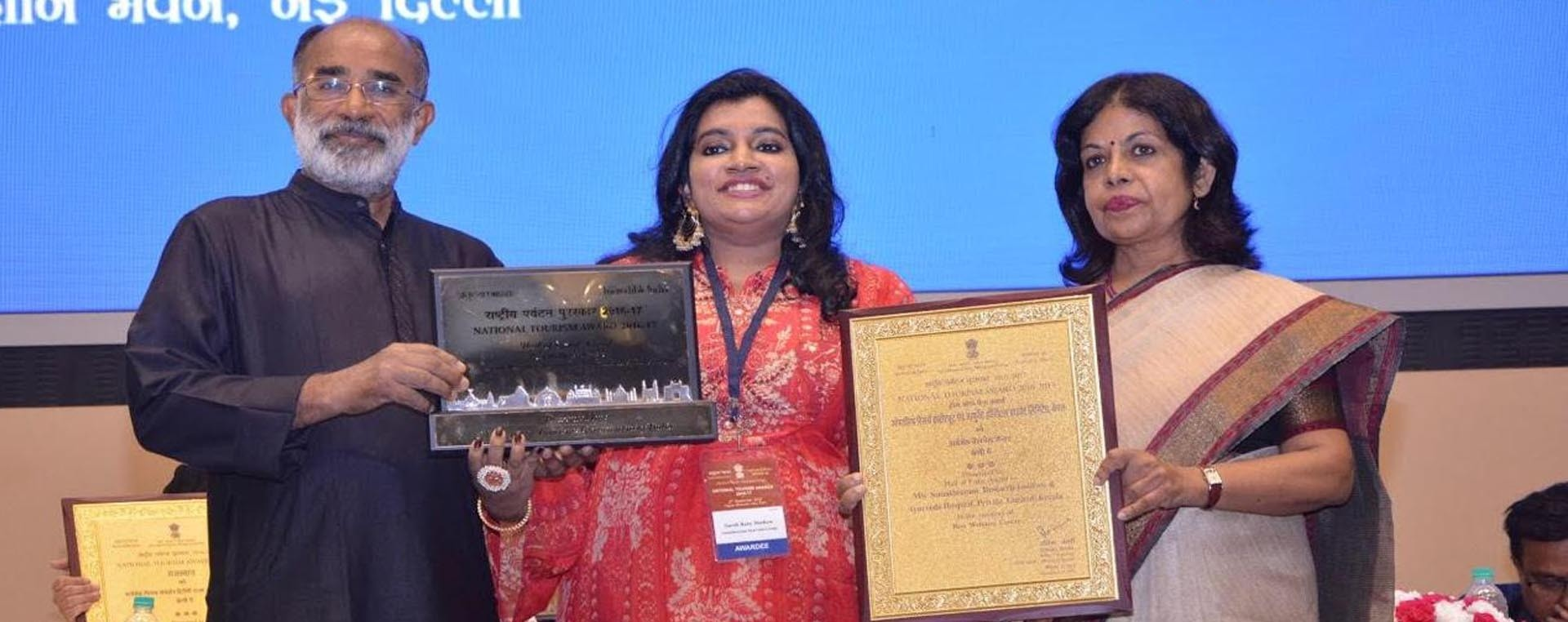 Mrs. Sarah Baby Mathew, Director of Somatheeram Ayurveda Group is receiving the National Tourism Award including 'HALL OF FAME' Award for the fourth time 'Best Ayurveda Wellness Centre' from honourable Union Minister of State for Tourism & Informatio