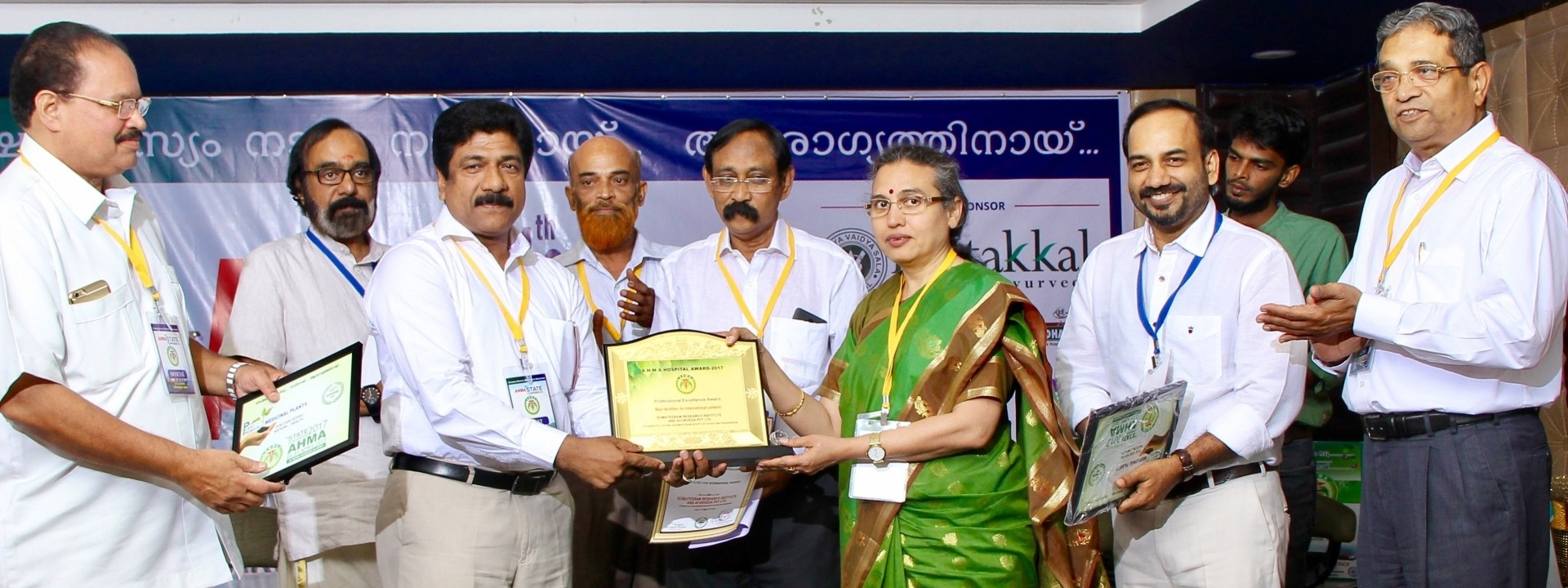 Somatheeram Ayurveda Group Chairman and Managing Director Mr.Baby Mathew receiving the AHMA award